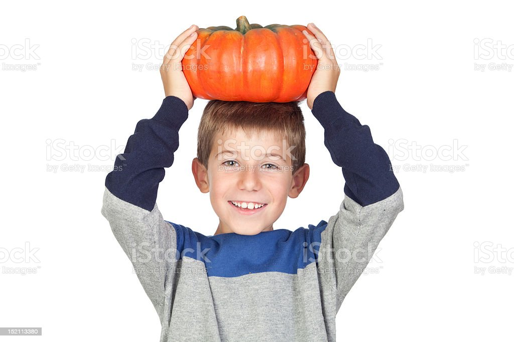 Adorable child with a big pumpkin stock photo