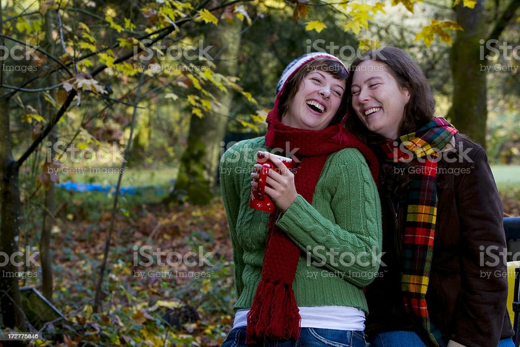 Adorable Daughter and Mother Laughing Outside on Fall Day royalty-free stock photo