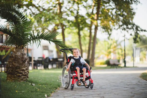 Adorable disabled boy in wheelchair Disabled boy in wheelchair sonderjylland stock pictures, royalty-free photos & images