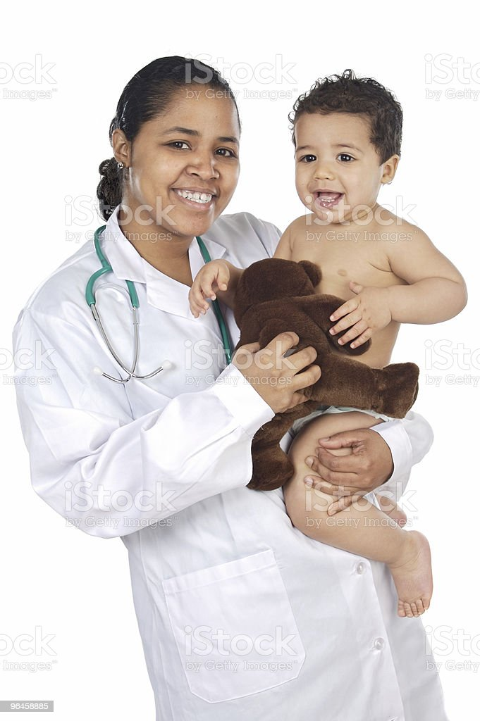Adorable doctor with a baby in her arms royalty-free stock photo