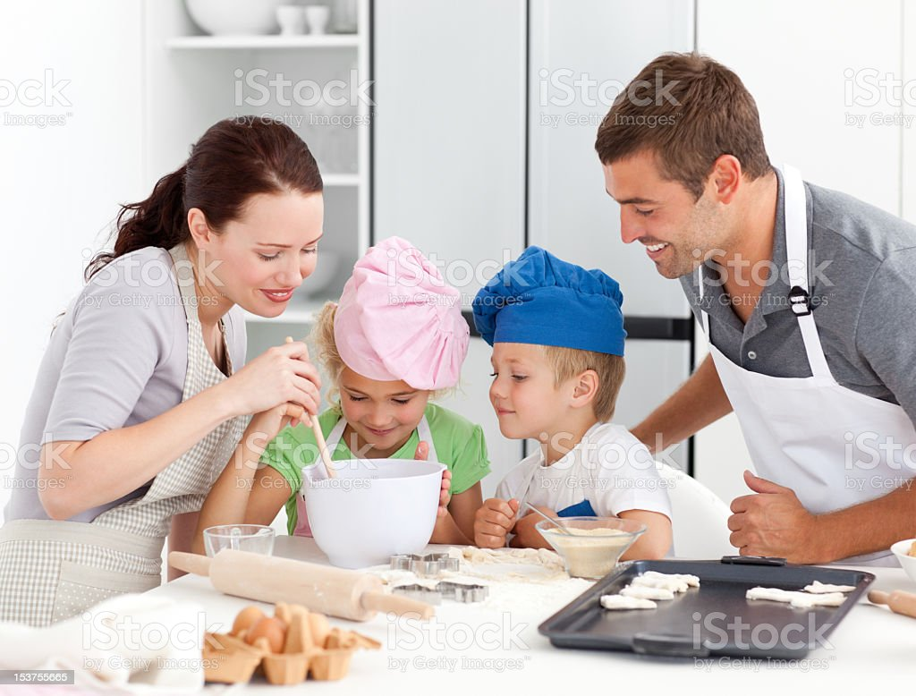 Adorable family baking together in the kitchen royalty-free stock photo
