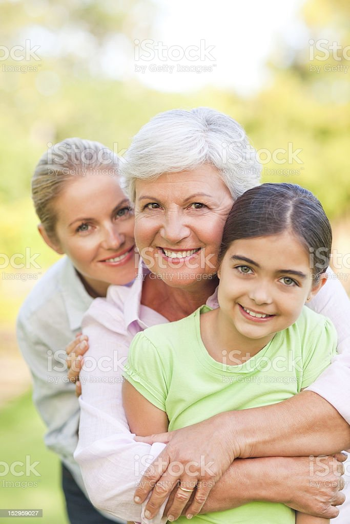 Adorable family in the park stock photo