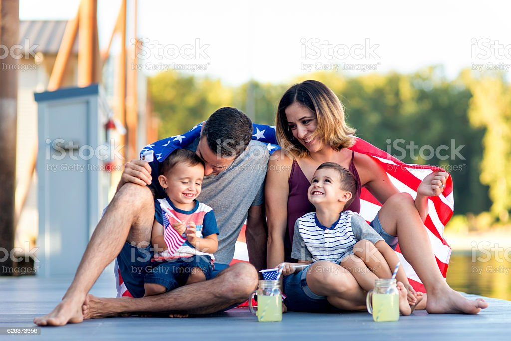Adorable family of four together on Independence Day stock photo