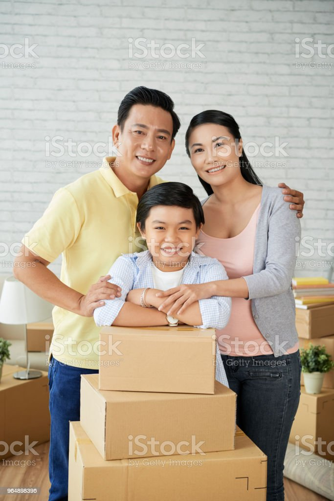 Adorable Family Relocating in New Apartment royalty-free stock photo