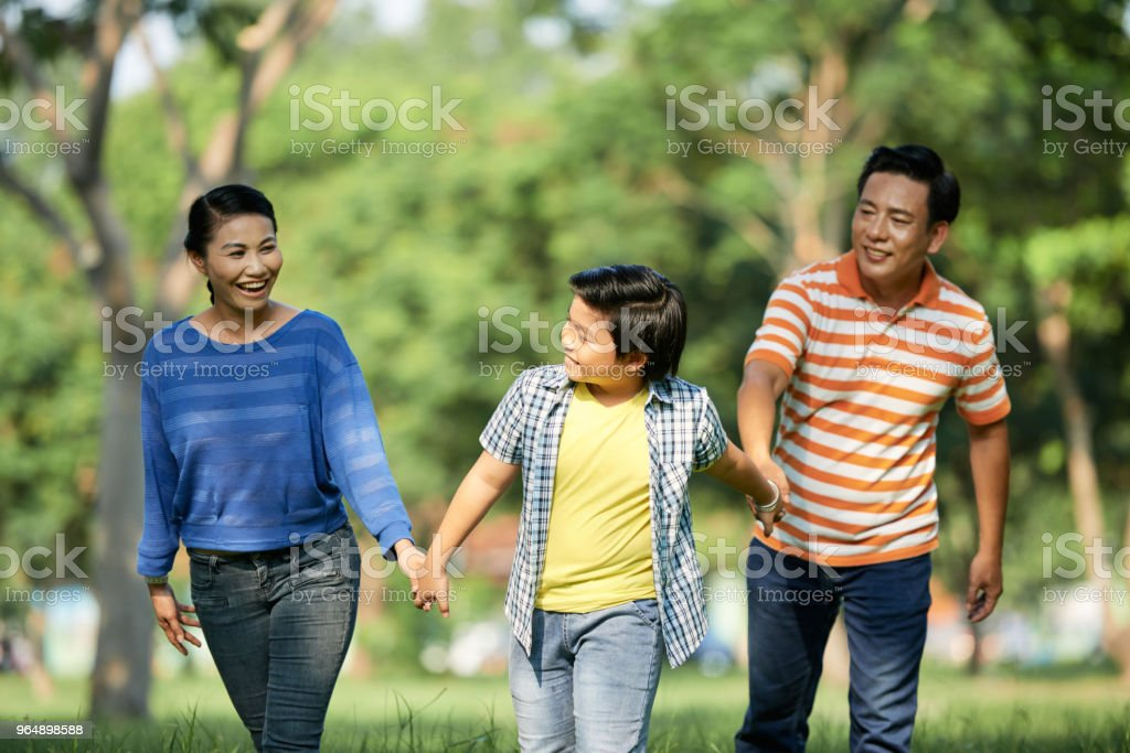 Adorable Family Spending Day Outdoors royalty-free stock photo