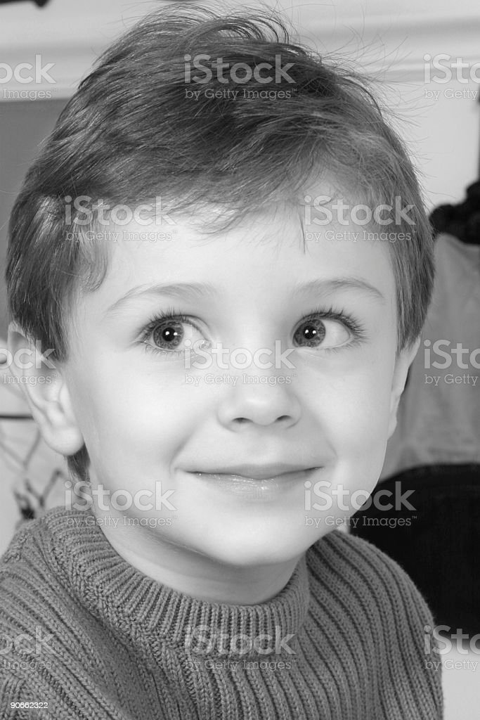 Adorable Four Year Old Boy with Big Blue Eyes stock photo