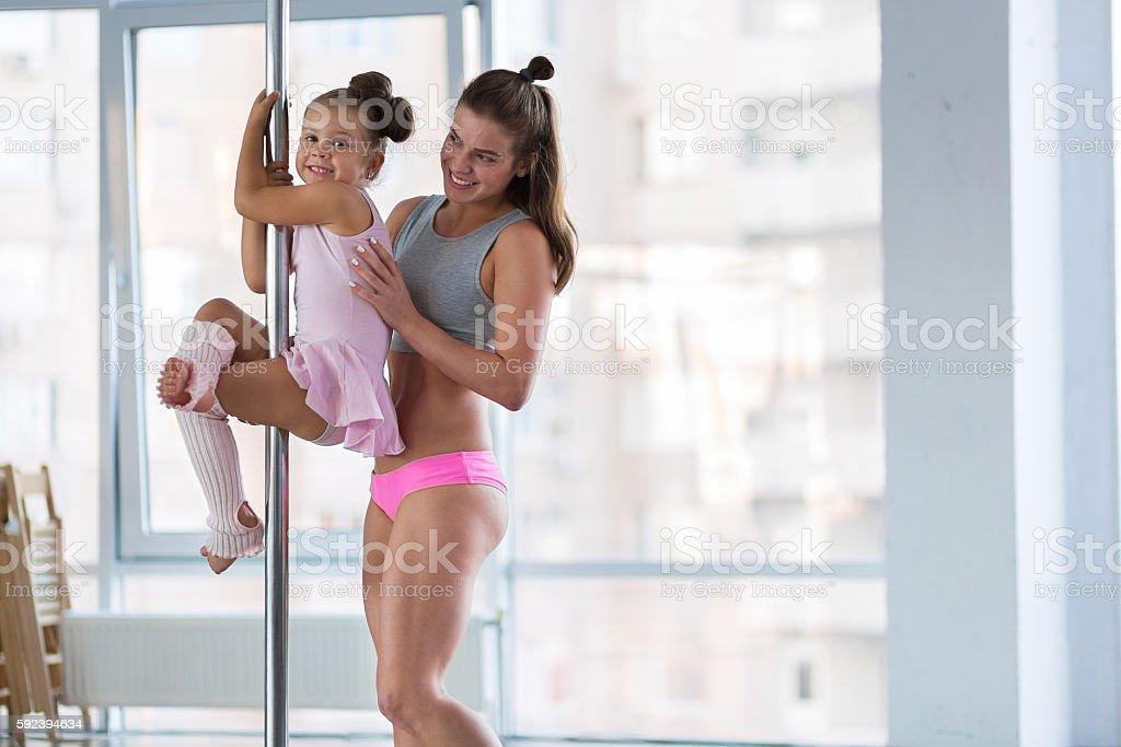 Adorable girl dancer in the ballet studio stock photo