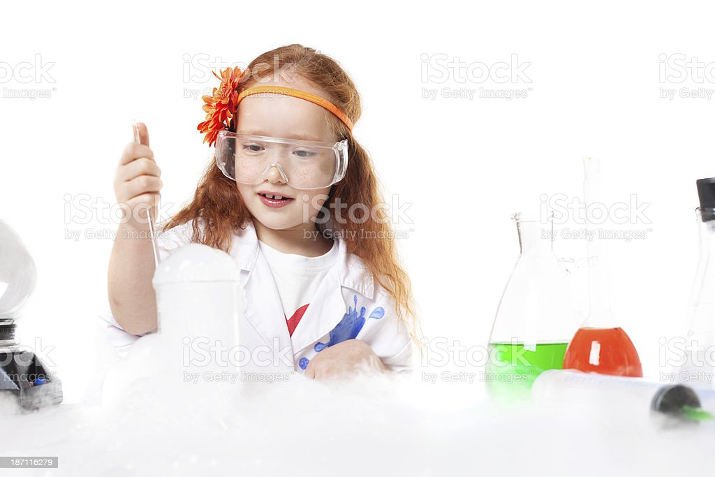 Adorable girl doing experiment, isolated on white royalty-free stock photo