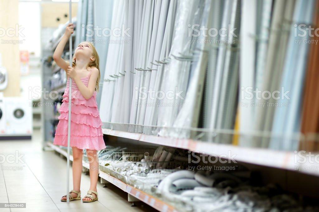 Adorable girl in a houseware store stock photo