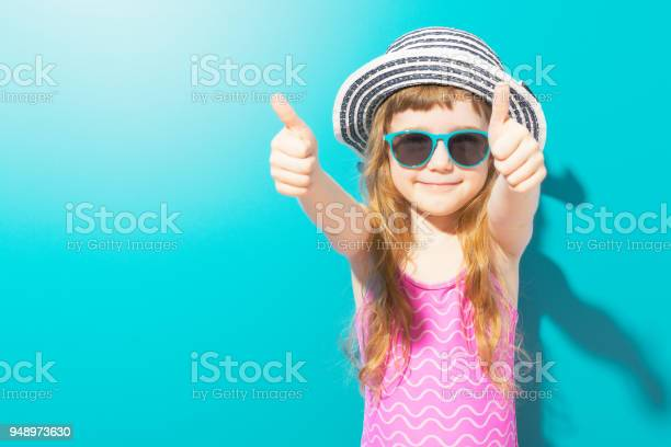 Adorable girl in swimsuit showing thumbs up picture id948973630?b=1&k=6&m=948973630&s=612x612&h=in0kc1r6enh2fwuh2cnazacra nnozyiexfjehpyr u=