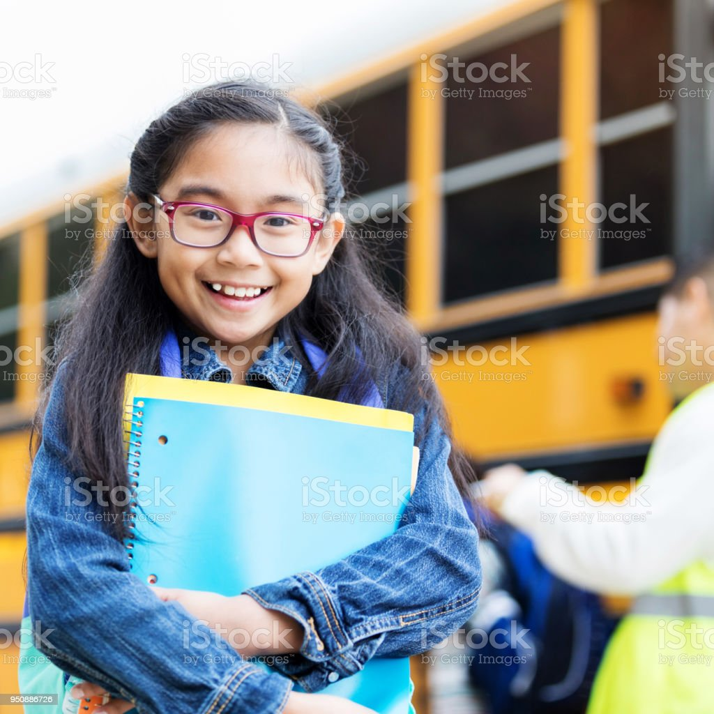 Adorable girl is excited about the first day of school stock photo