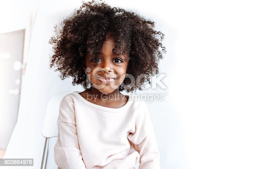 istock Adorable girl looking at camera 603864978