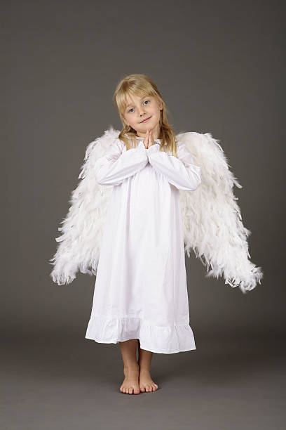 adorable girl with angel wings in amen gesture adorable girl with angel wings in amen gesture Amen stock pictures, royalty-free photos & images