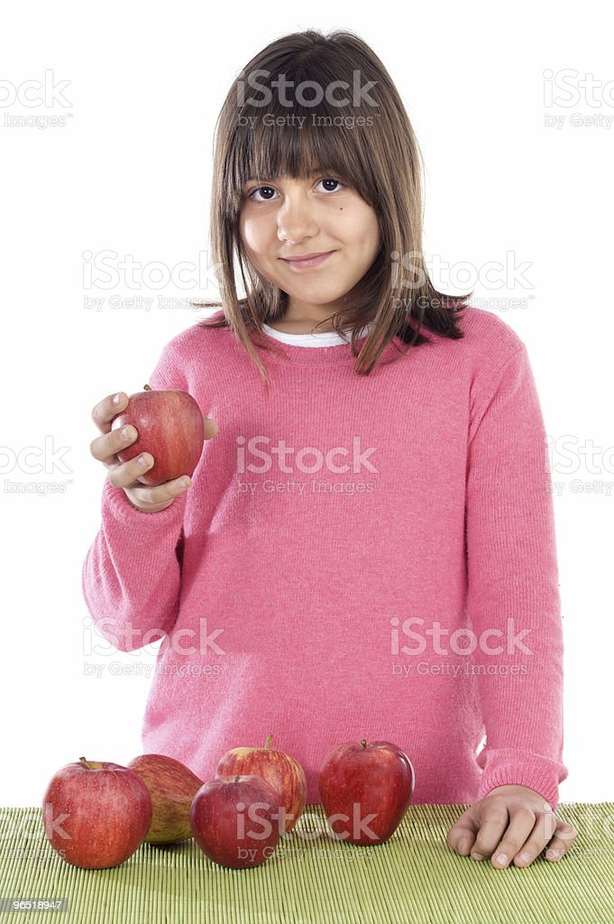 Adorable girl with red apples royalty-free stock photo