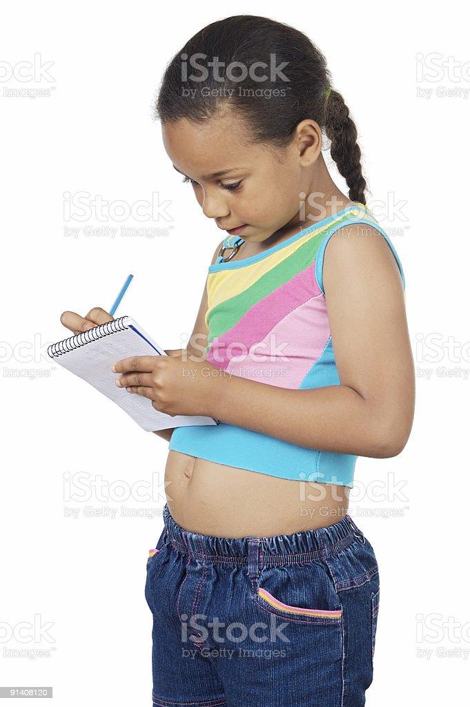 adorable girl writing royalty-free stock photo