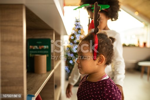 istock Adorable girls at home 1070015610