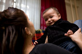 istock Adorable Hispanic Baby Boy Playing with Mother at Home, Copyspace 173867200