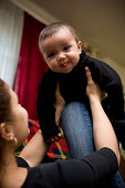 istock Adorable Hispanic Baby Boy Playing with Mother at Home 174631027