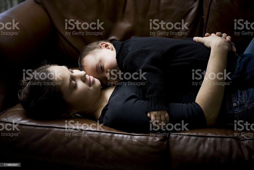 Adorable Hispanic Baby Boy Sleeping on Mother at Home, Copyspace royalty-free stock photo