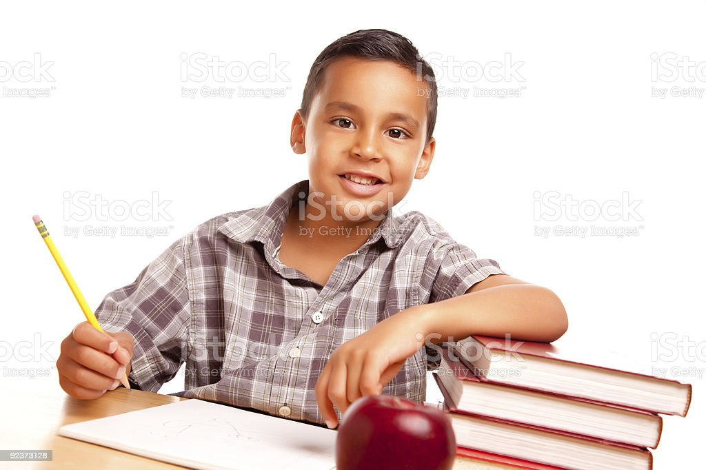 Adorable Hispanic Boy with Books, Apple, Pencil and Paper royalty-free stock photo