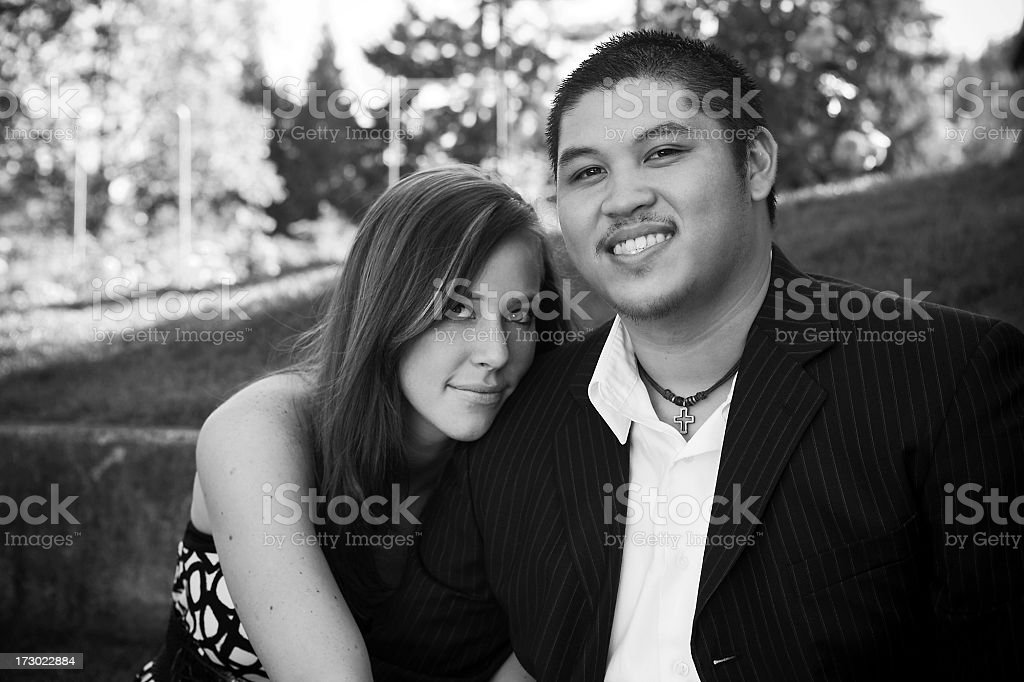 Adorable Interracial Young Couple Embracing, Black and White, Copy Space stock photo