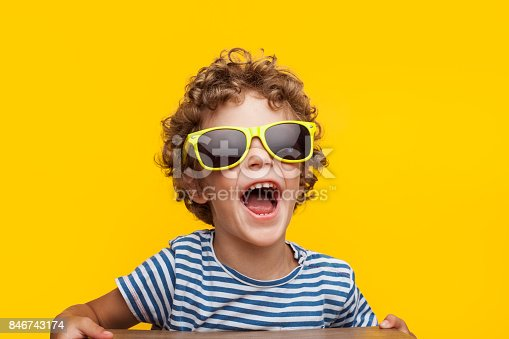 istock Adorable kid in bright sunglasses on orange 846743174