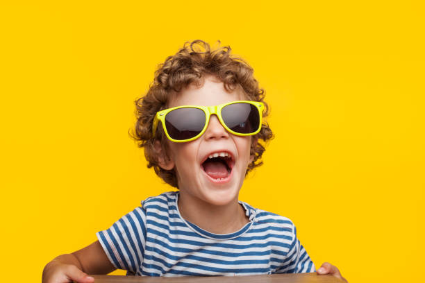 adorable kid in bright sunglasses on orange - child stock photos and pictures