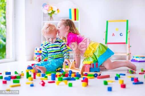 istock Adorable kids playing at day care 476541228