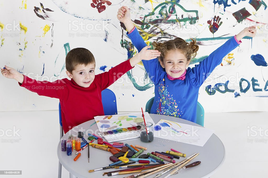 Adorable kids proud of their art off work royalty-free stock photo
