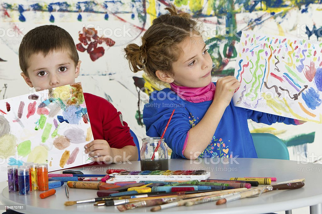 Adorable kids showing their art of work royalty-free stock photo