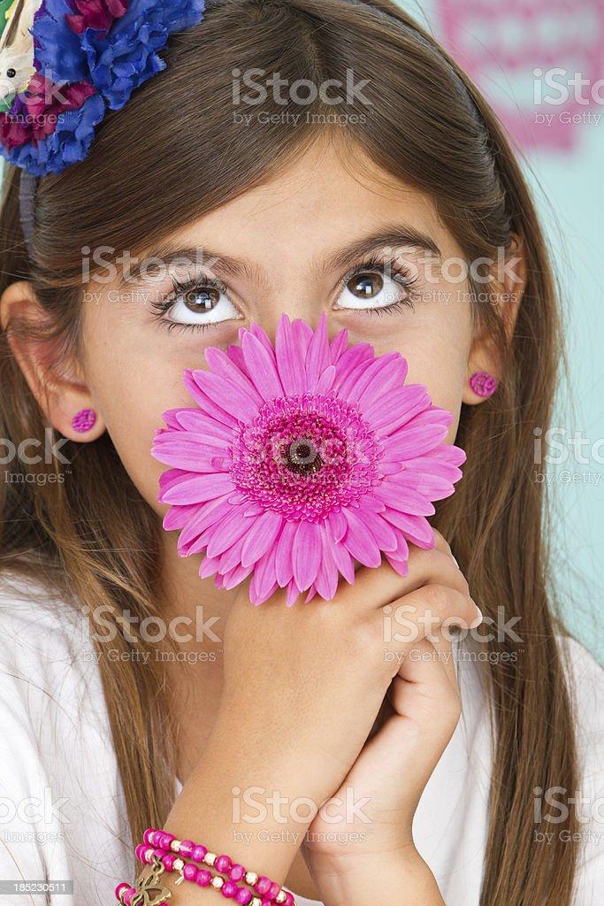 Adorable latin american girl with gerbera royalty-free stock photo