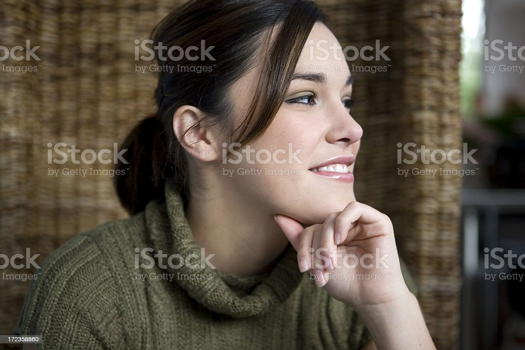 Adorable Latina Young Woman Listening to Friend in Cafe, Profile royalty-free stock photo