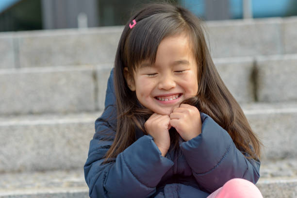 Adorable little Asian girl with a lovely smile stock photo