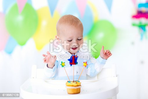 istock Adorable little baby boy celebrating first birthday 619982128