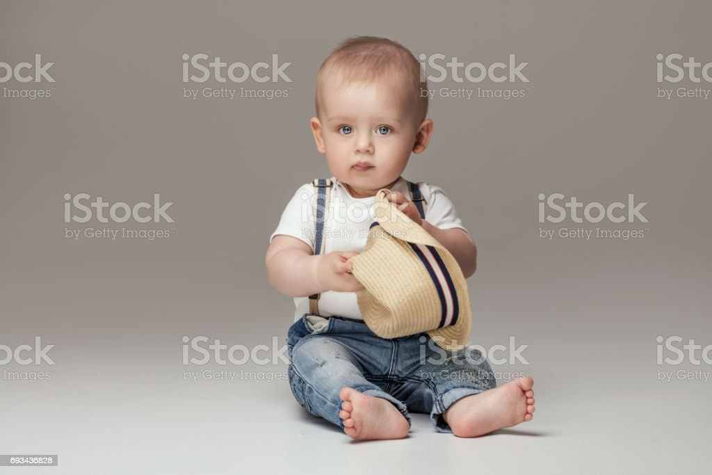 Adorable little baby boy posing. stock photo
