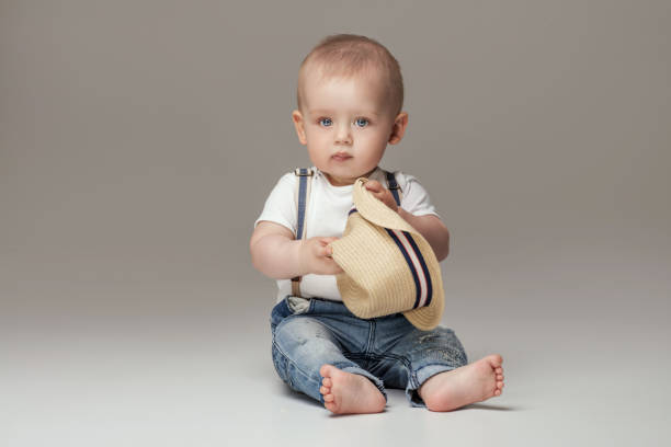 adorable little baby boy posing. - baby boys stock photos and pictures