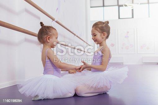 1160198096 istock photo Adorable little ballerinas at dancing school 1160198094