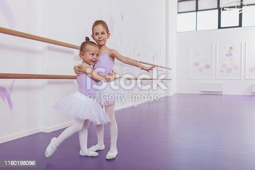istock Adorable little ballerinas at dancing school 1160198096