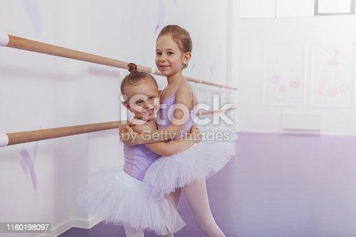 1160198096 istock photo Adorable little ballerinas at dancing school 1160198097