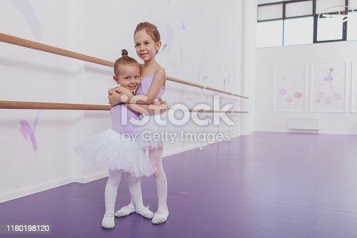1160198096 istock photo Adorable little ballerinas at dancing school 1160198120