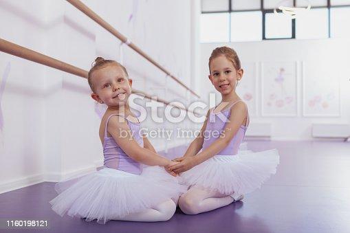 1160198096 istock photo Adorable little ballerinas at dancing school 1160198121