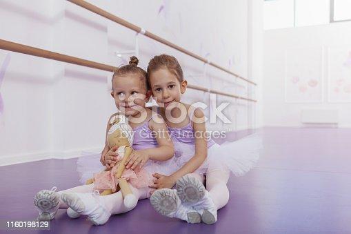 1160198096 istock photo Adorable little ballerinas at dancing school 1160198129