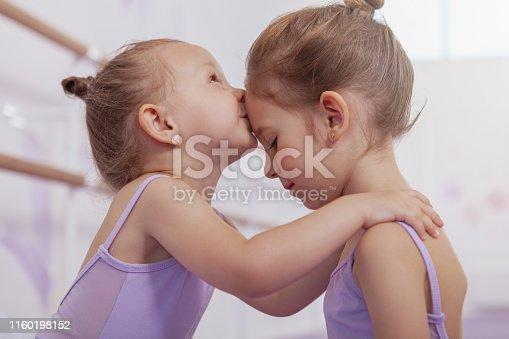 1160198096 istock photo Adorable little ballerinas at dancing school 1160198152