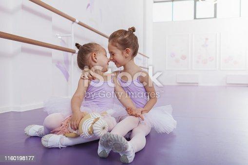1160198096 istock photo Adorable little ballerinas at dancing school 1160198177