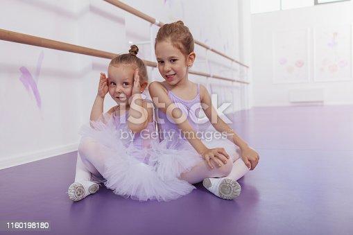 1160198096 istock photo Adorable little ballerinas at dancing school 1160198180