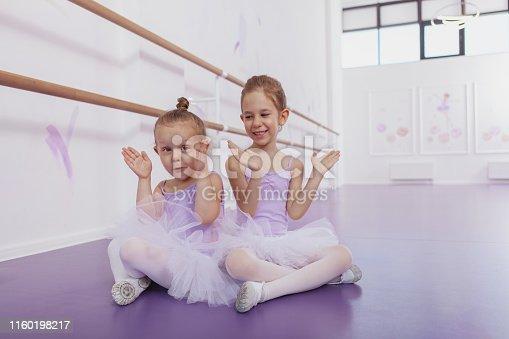 1160198096 istock photo Adorable little ballerinas at dancing school 1160198217