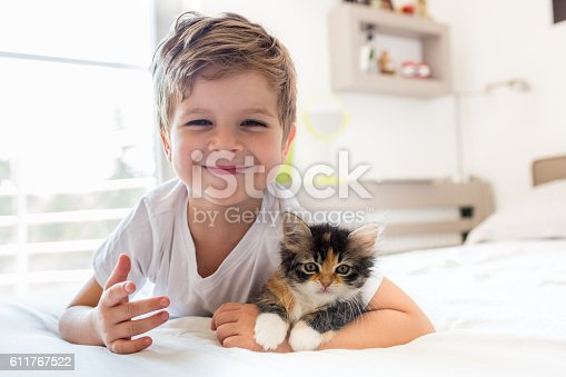 istock Adorable little boy and his kitten! 611767522