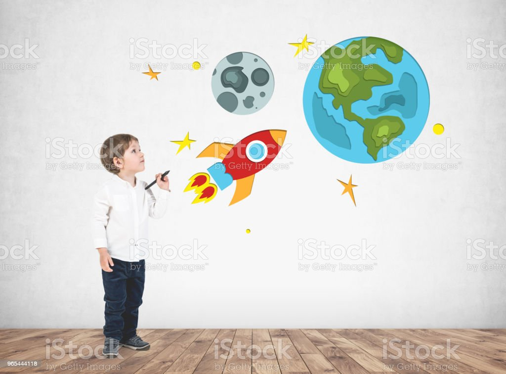 Adorable little boy drawing space travel royalty-free stock photo