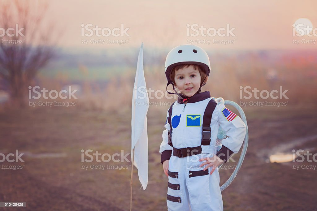 Adorable little boy, dressed as astronaut stock photo