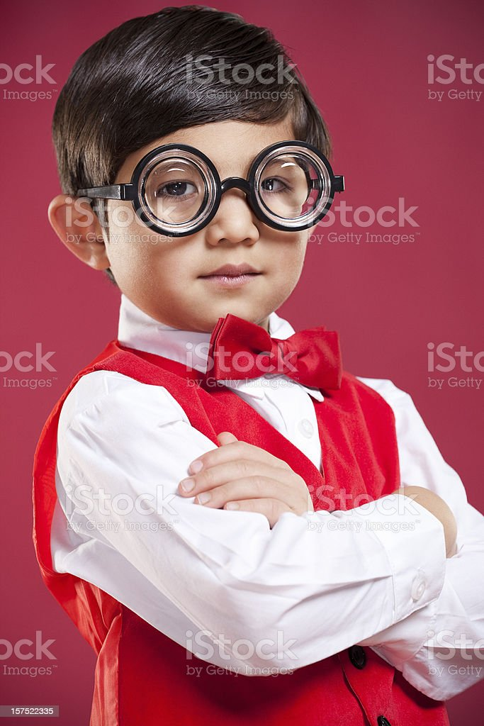 Adorable Little Boy Nerd with Glasses and Bowtie on Red royalty-free stock photo